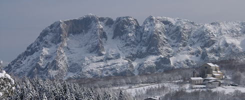 View of Urkiola Sanctuary with the Alluitz behind. Winter